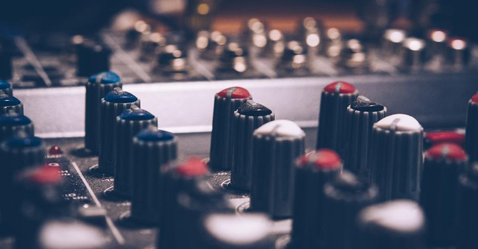 Studio soundboard buttons and dials closeup