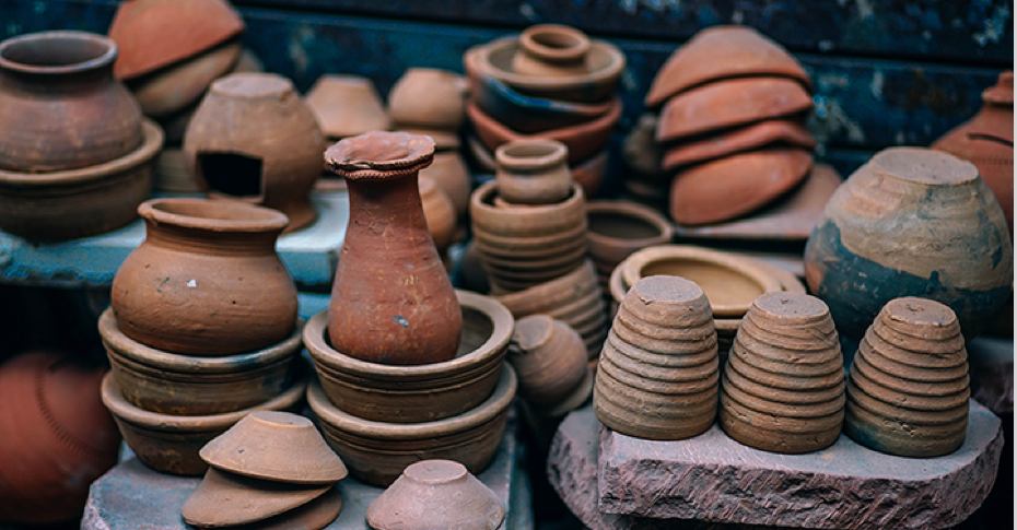 Mexican clay pottery stand with bowls and vases