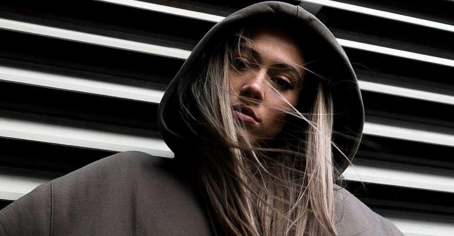 Streetwear woman wearing grey hoodie - cream magazine