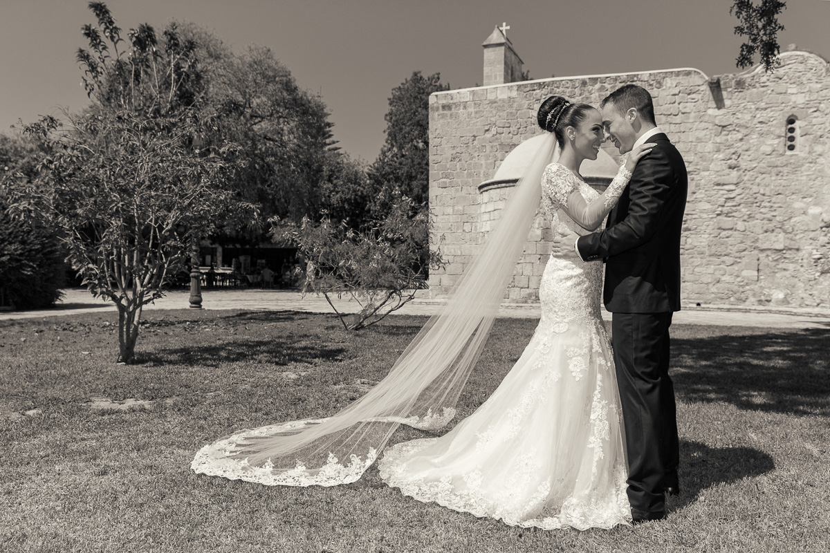 portrait of beautiful bride and groom outside the church