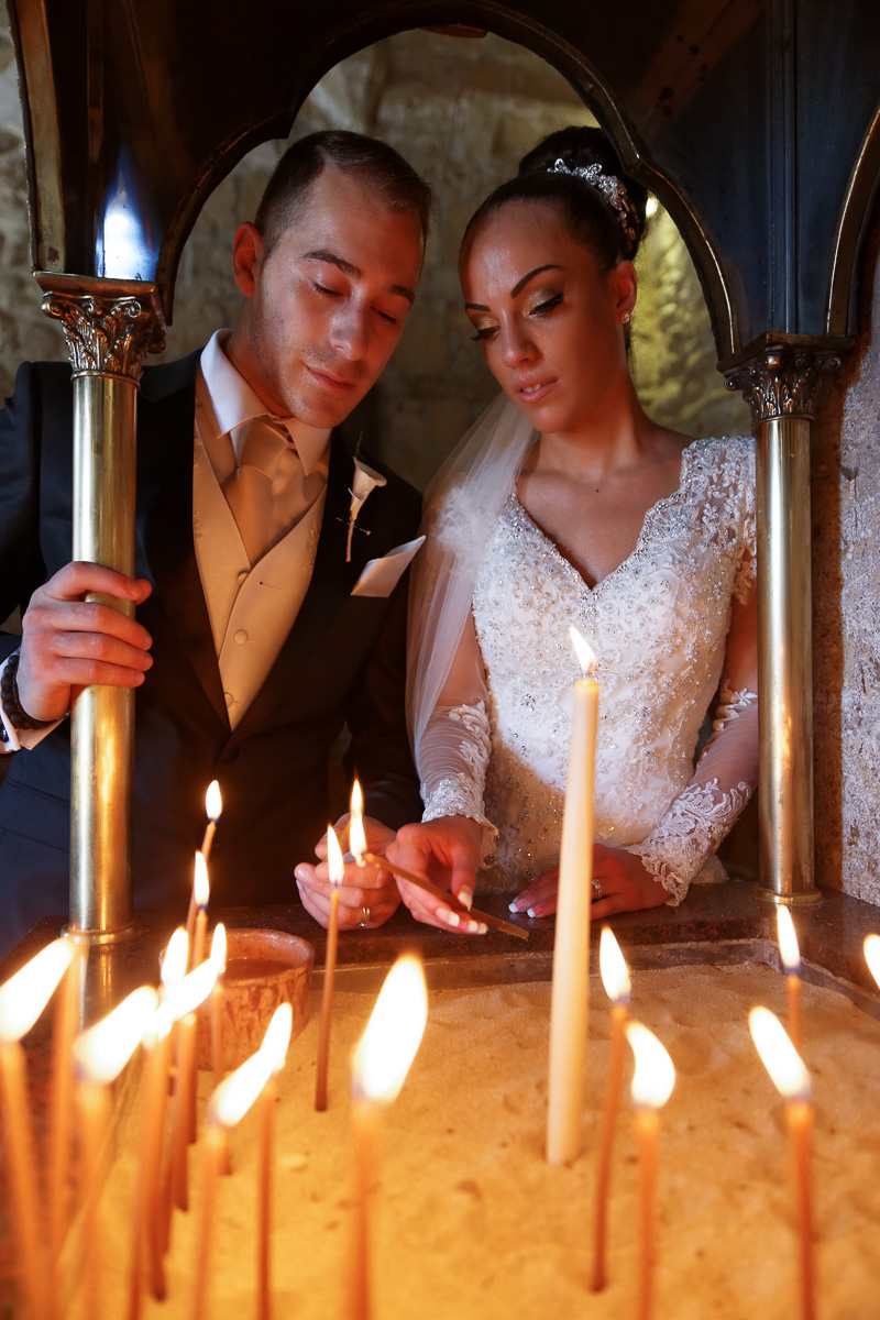 lighting candles inside the orthodox church