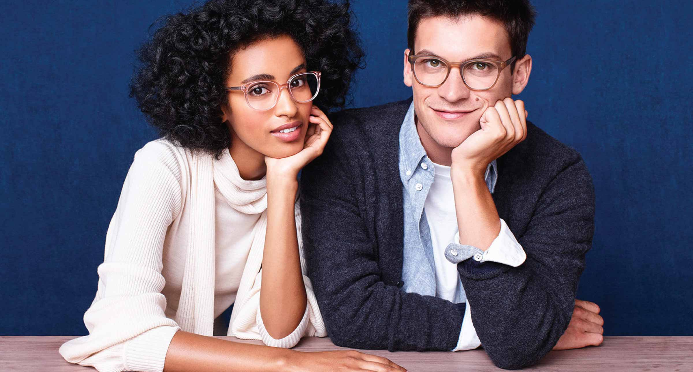 Woman and Man modelling Warby Parker eyeglasses