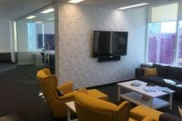 Acquia break out room with textured wall finish