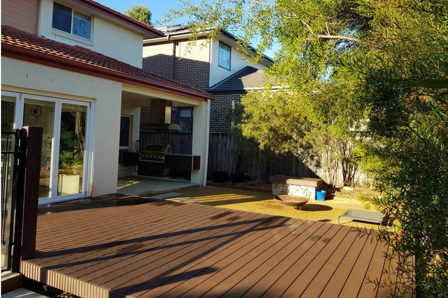 Low level decking constructed using maintenance free composite decking boards