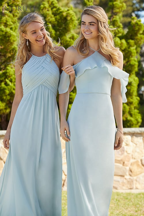 Two bridesmaids wearing blue dresses