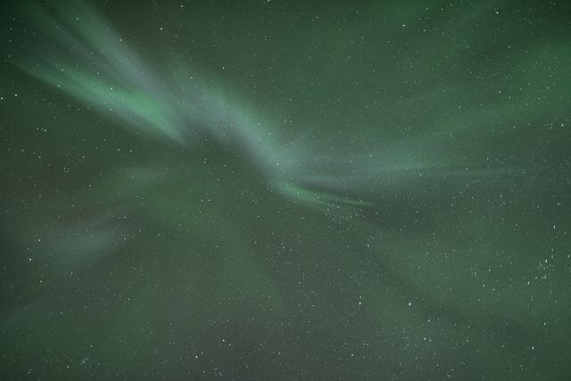 Northern lights hunting photography Rovaniemi by minibus