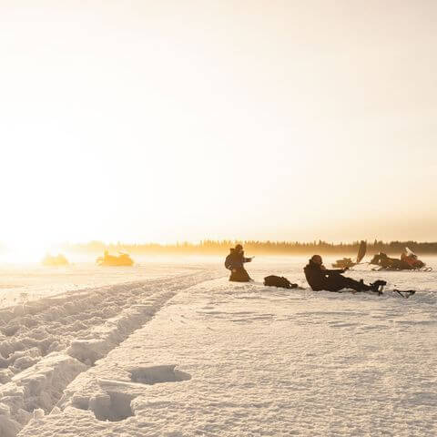 Snowmobile Safari with Ice Fishing and Campfire Lunch