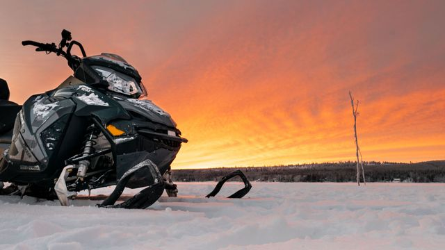 Full day snowmobile safari with lunch and ice fishing experience