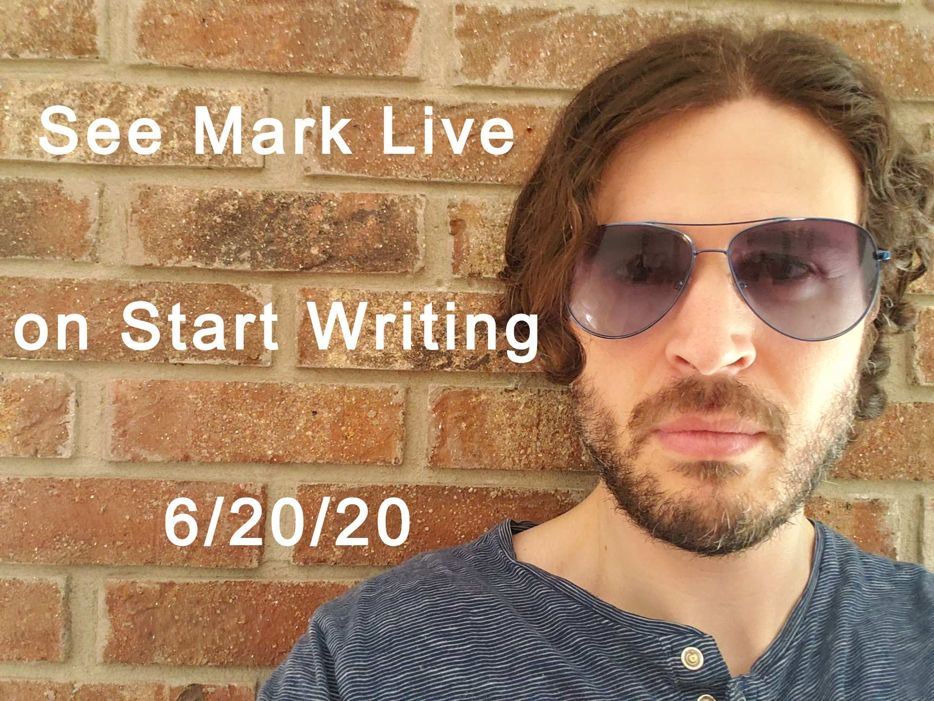 Mark Everglade cyberpunk author in blue shirt and glasses