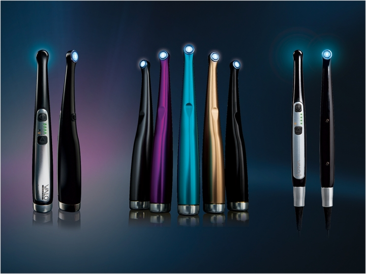 Various dental curing lights.