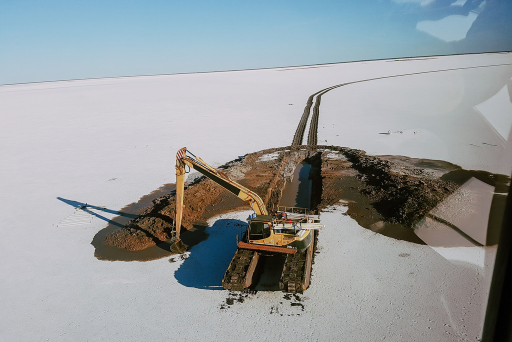 Removing Salt Australia with floating Excavator