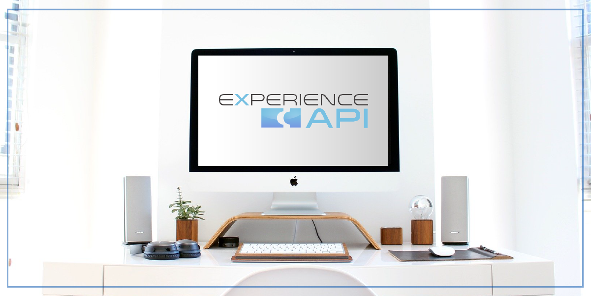Computer on a desk displaying the xAPI logo on its screen