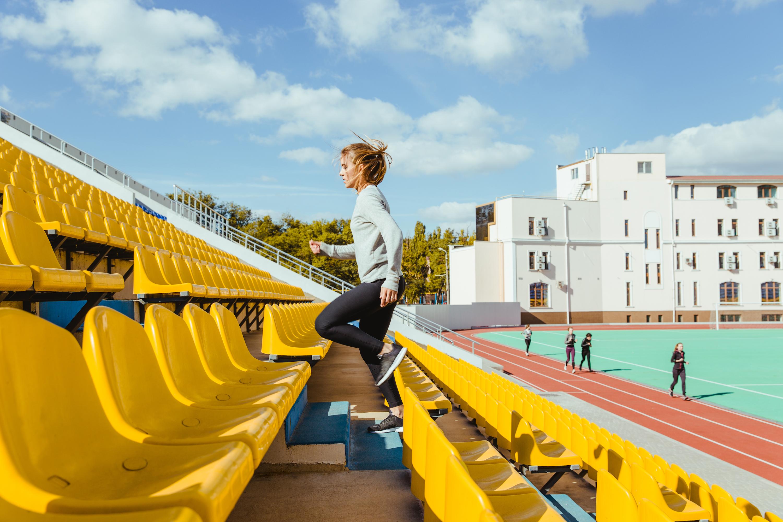 Athlete running up stairs