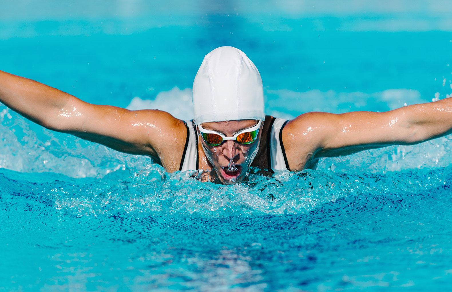 Female competitive athlete swimming