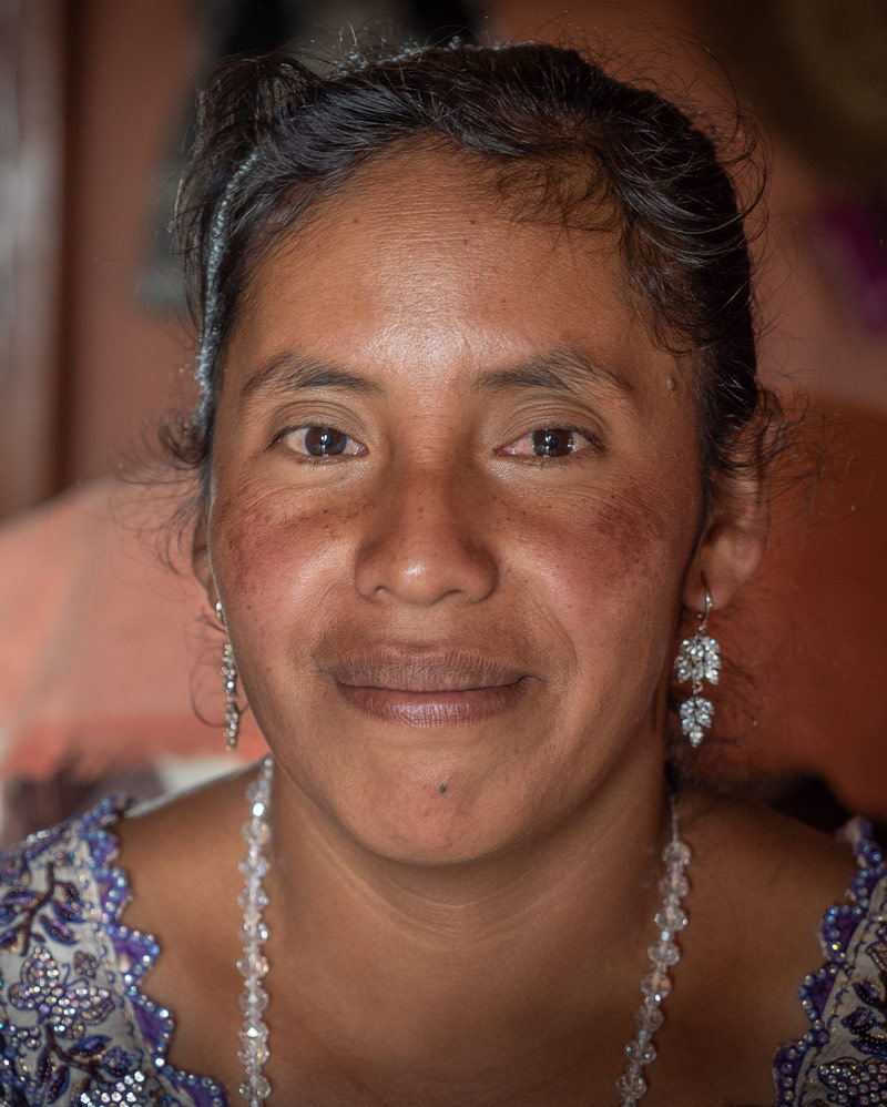Indigenous Guatemalan woman speaking into a micrphone