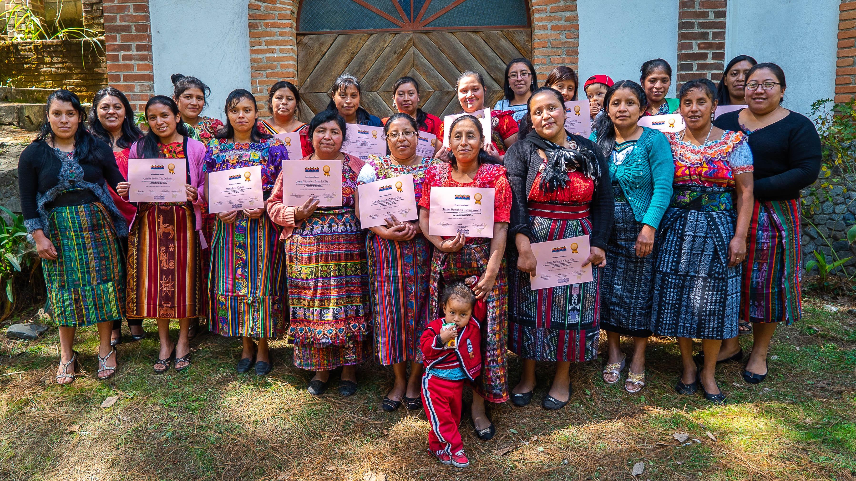 Guatemalan women holding certificates