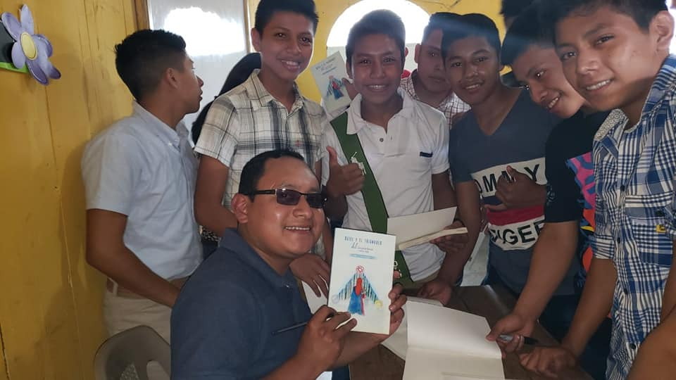 author signing his book for school children