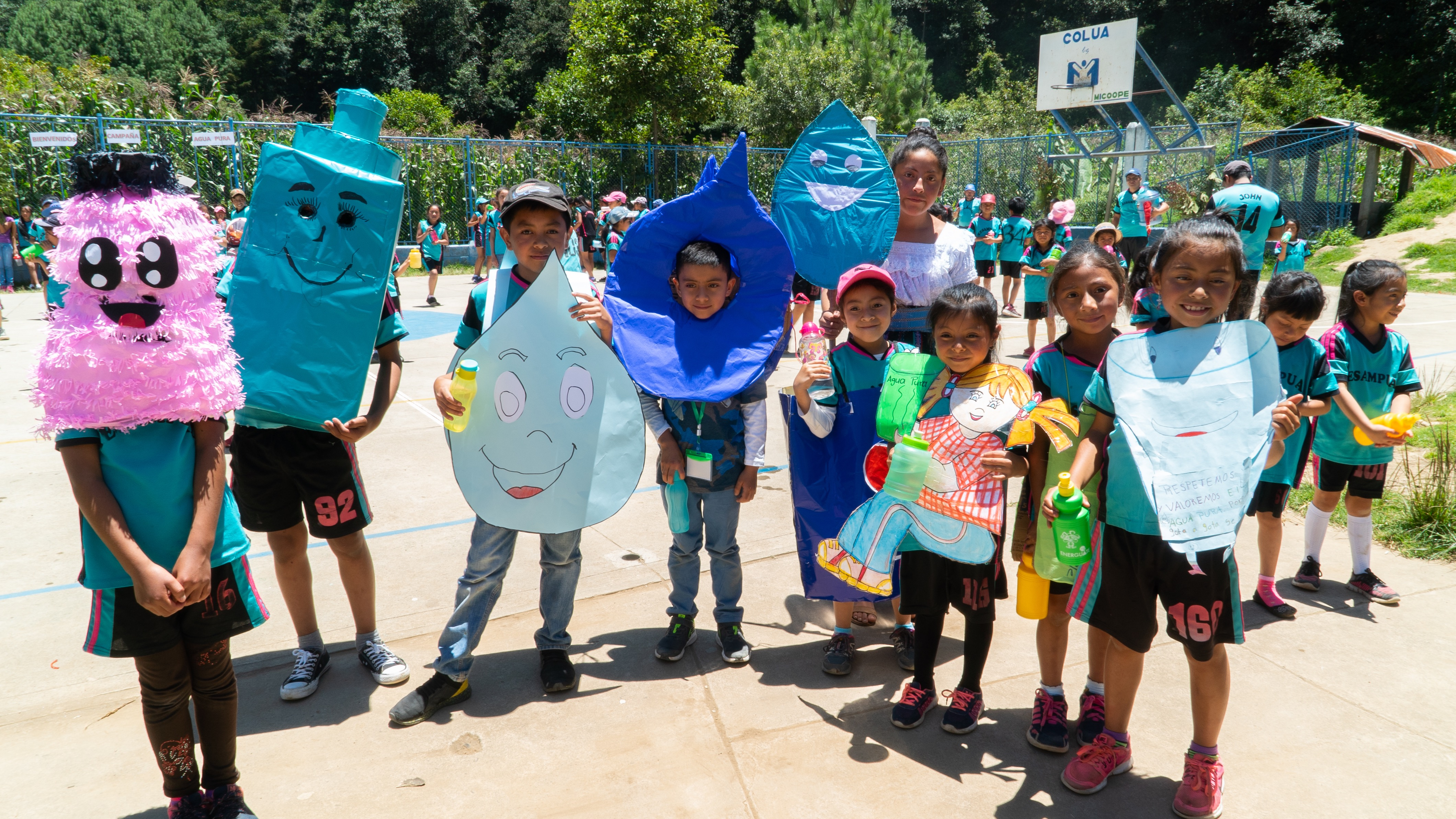 Guatemalan children dressed in water themed costumes