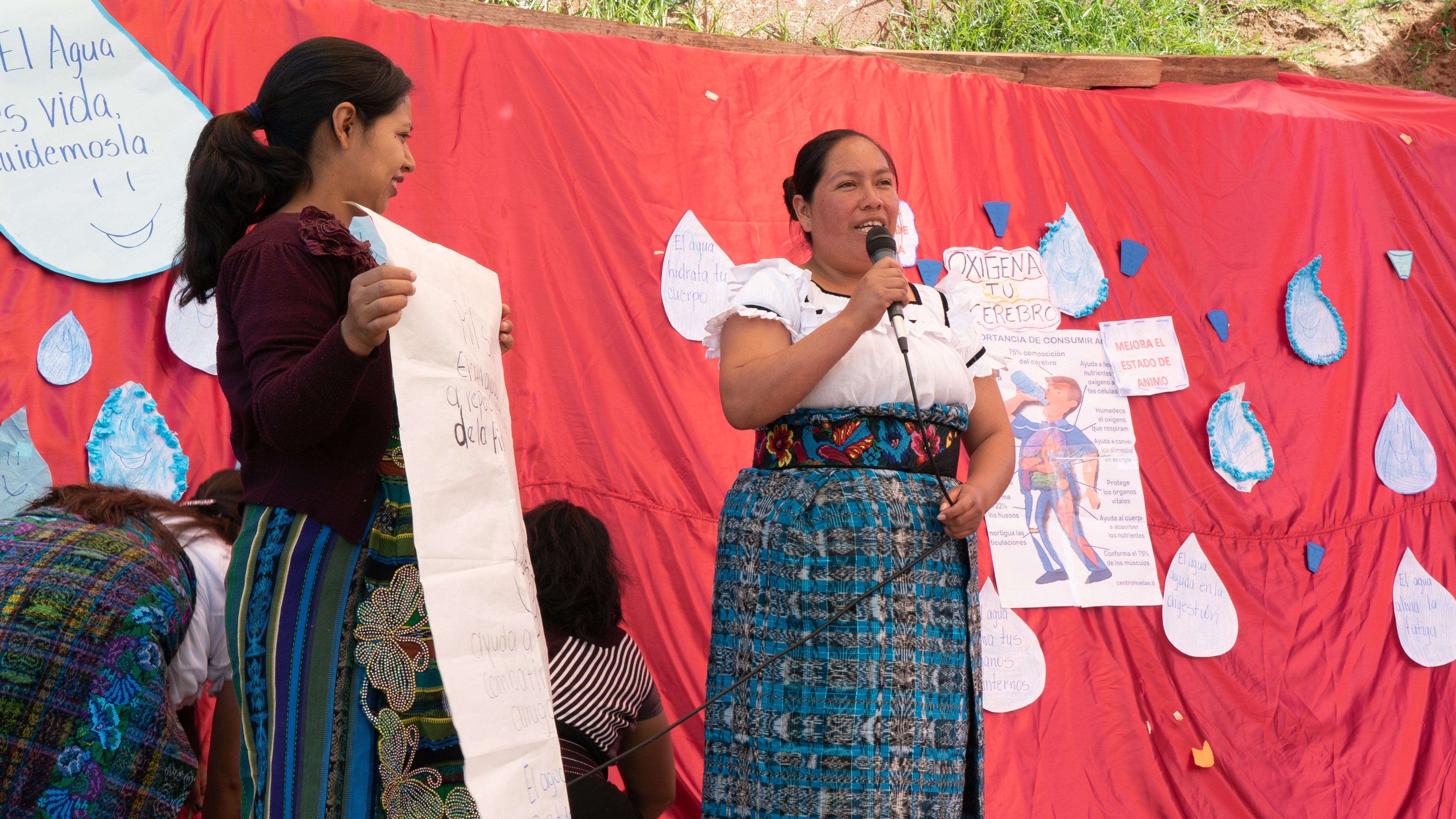 Guatemalan mothers giving presentation