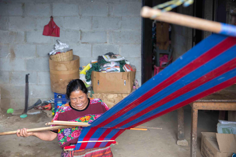 Indigenous woman uses backstrap loom