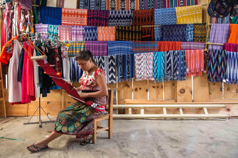 Guatemalan woman using backstrap loom