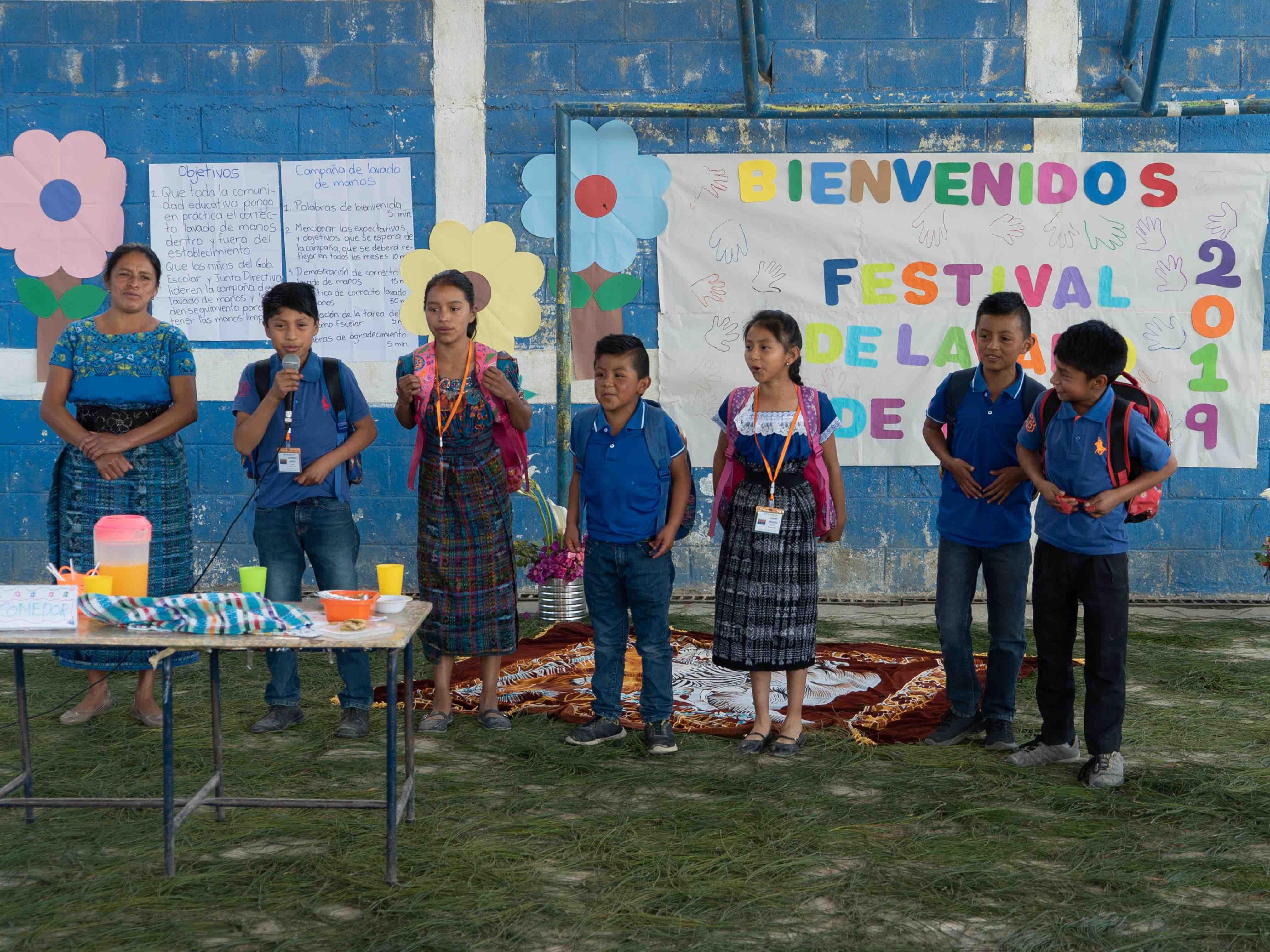 Guatemalan boy speaking into microphone
