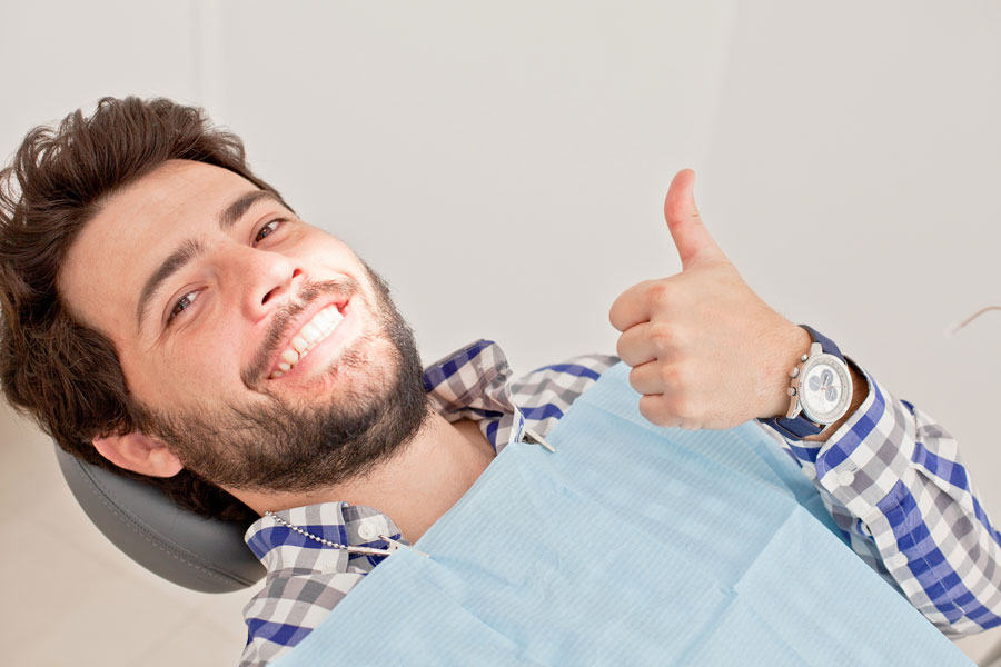 Picture of man giving a thumbs up at the dentist
