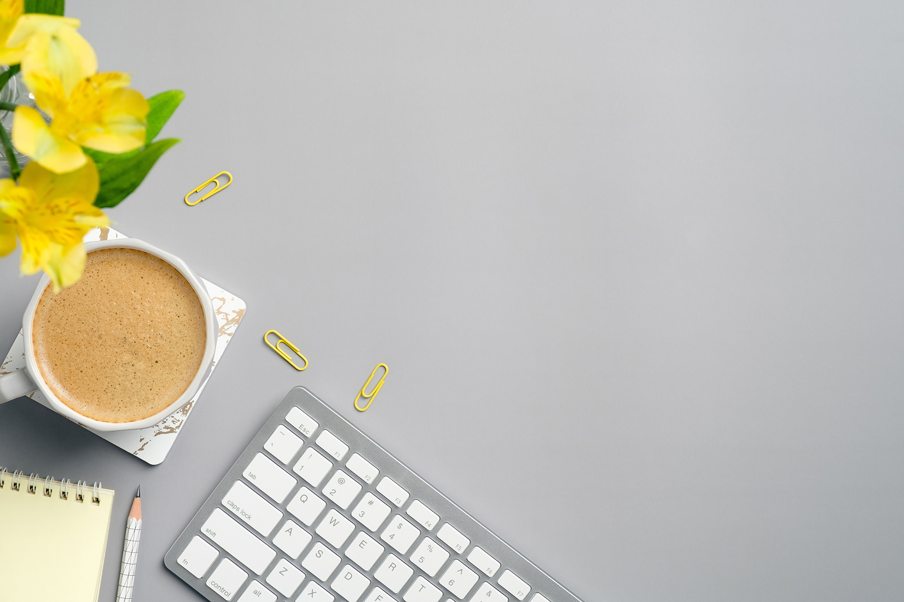 symbol image: compter keyboard, cup of coffe, notepad and flowers