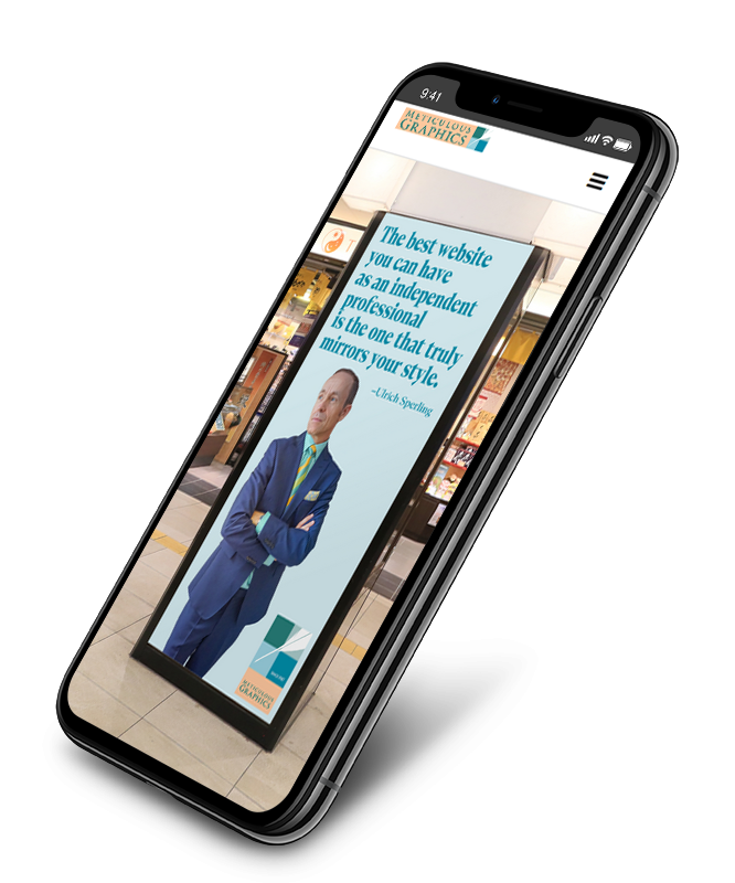 mockup of iphone showing website of Meticulous Graphics