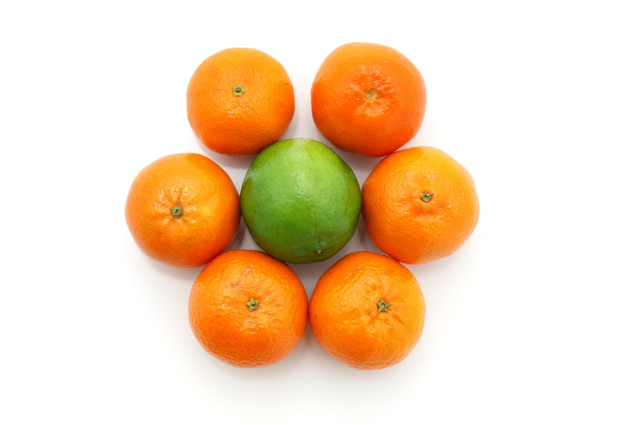 Lime Essential Oil: lime surrounded by oranges