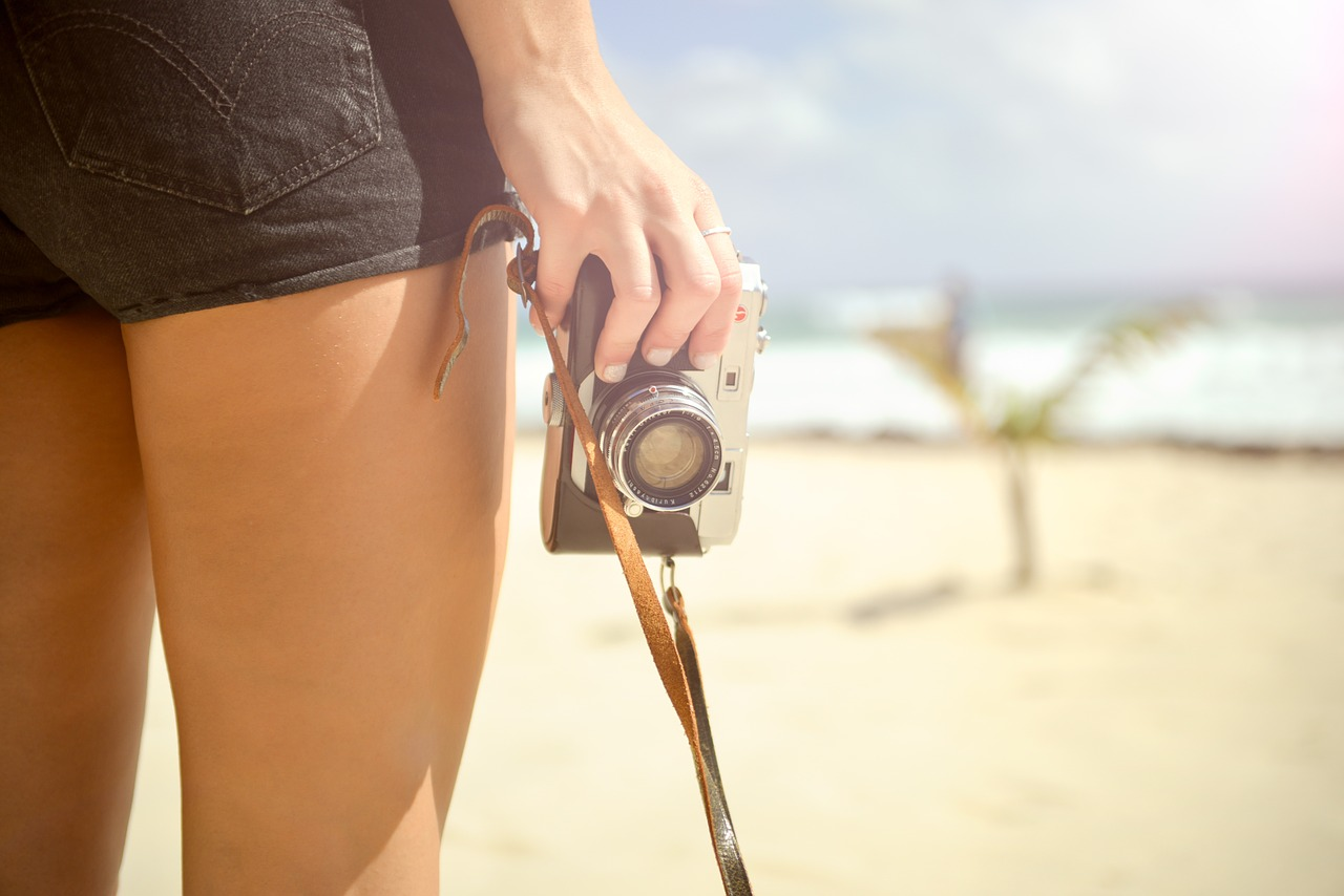Essential Oils For Cellulite: women holding camera