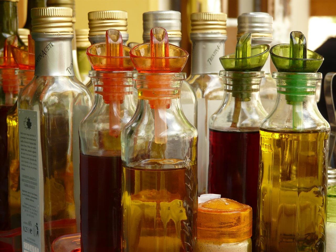 Apple Cider Vinegar Vs. White Vinegar: liquids in bottles