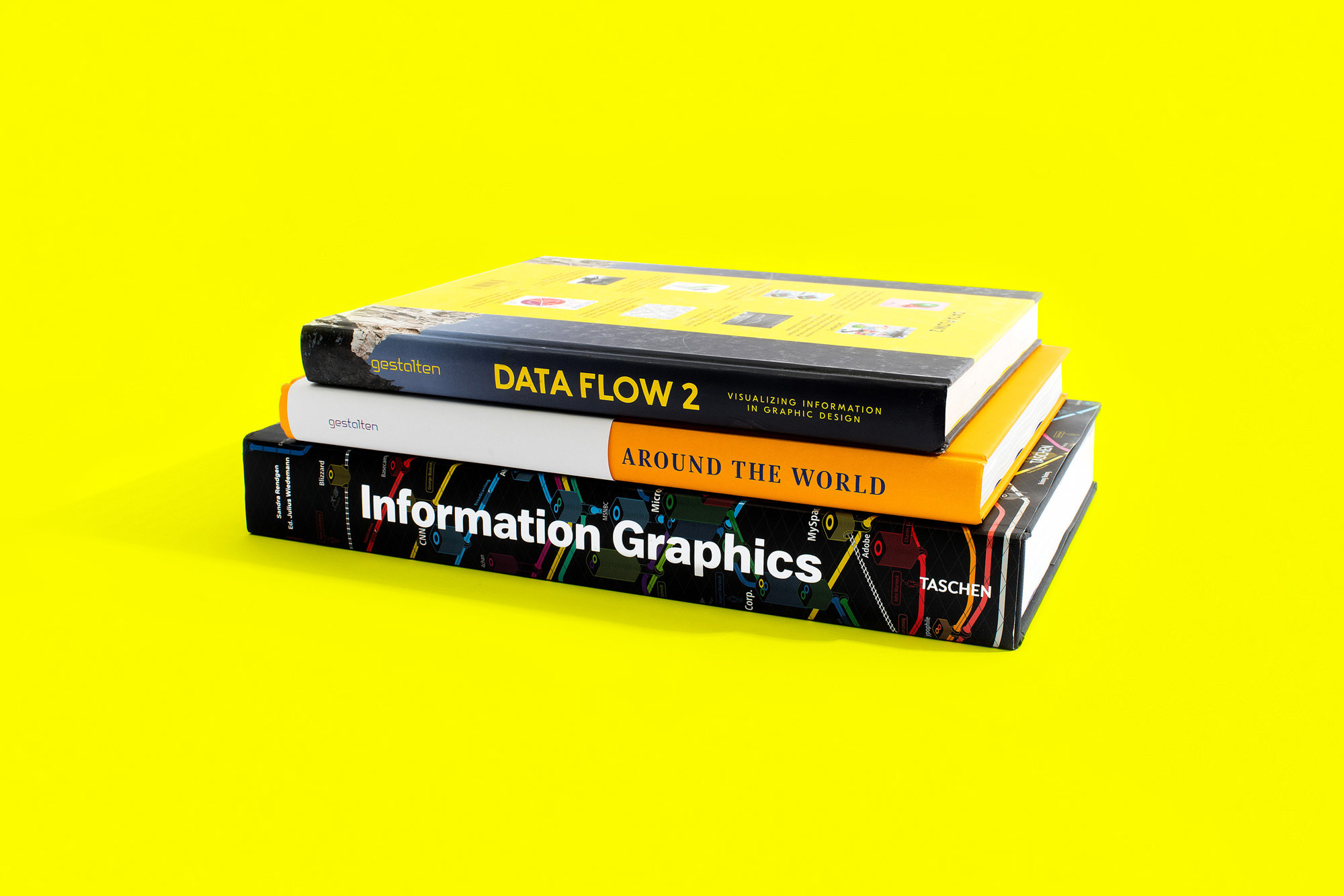 Stack of three infographics books