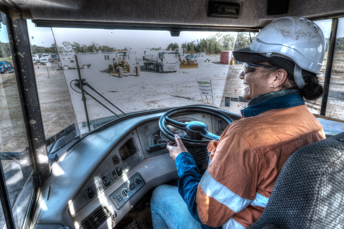 Prestart checks by a skilled operator of a large dump truck, captured by a professional photographer skilled in construction photography