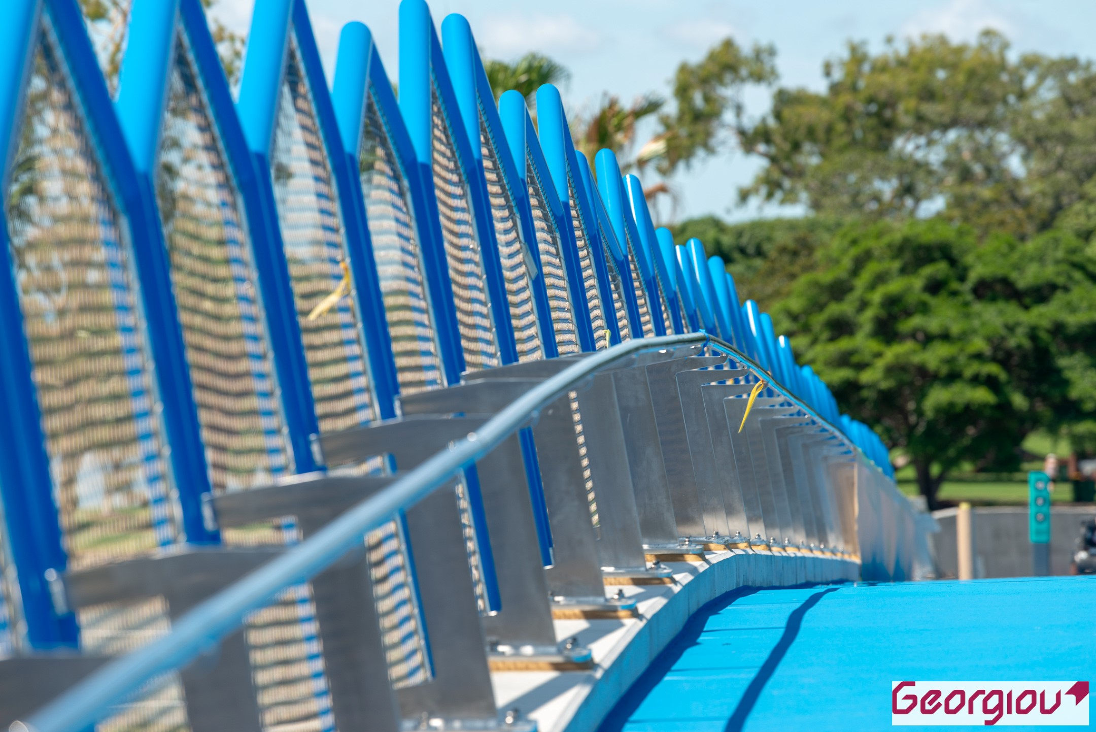 Vivid blue barriers on the new Green Bridge on the Gold Coast, by a professional photographer employed by Rapax Construction Photography