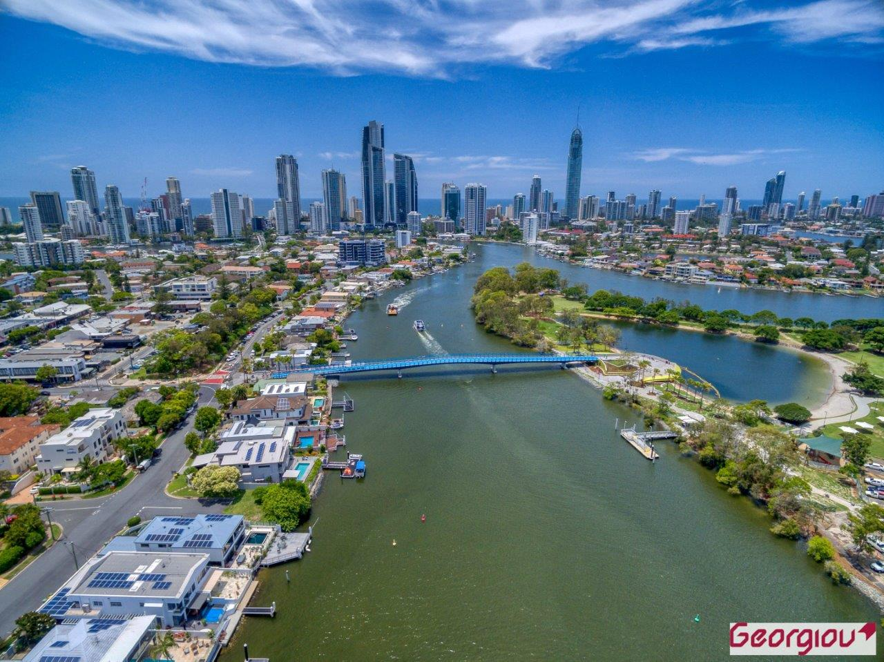 Aerial view of the new Green Bridge with the Gold Coast in the background, by Rapax Construction Photography