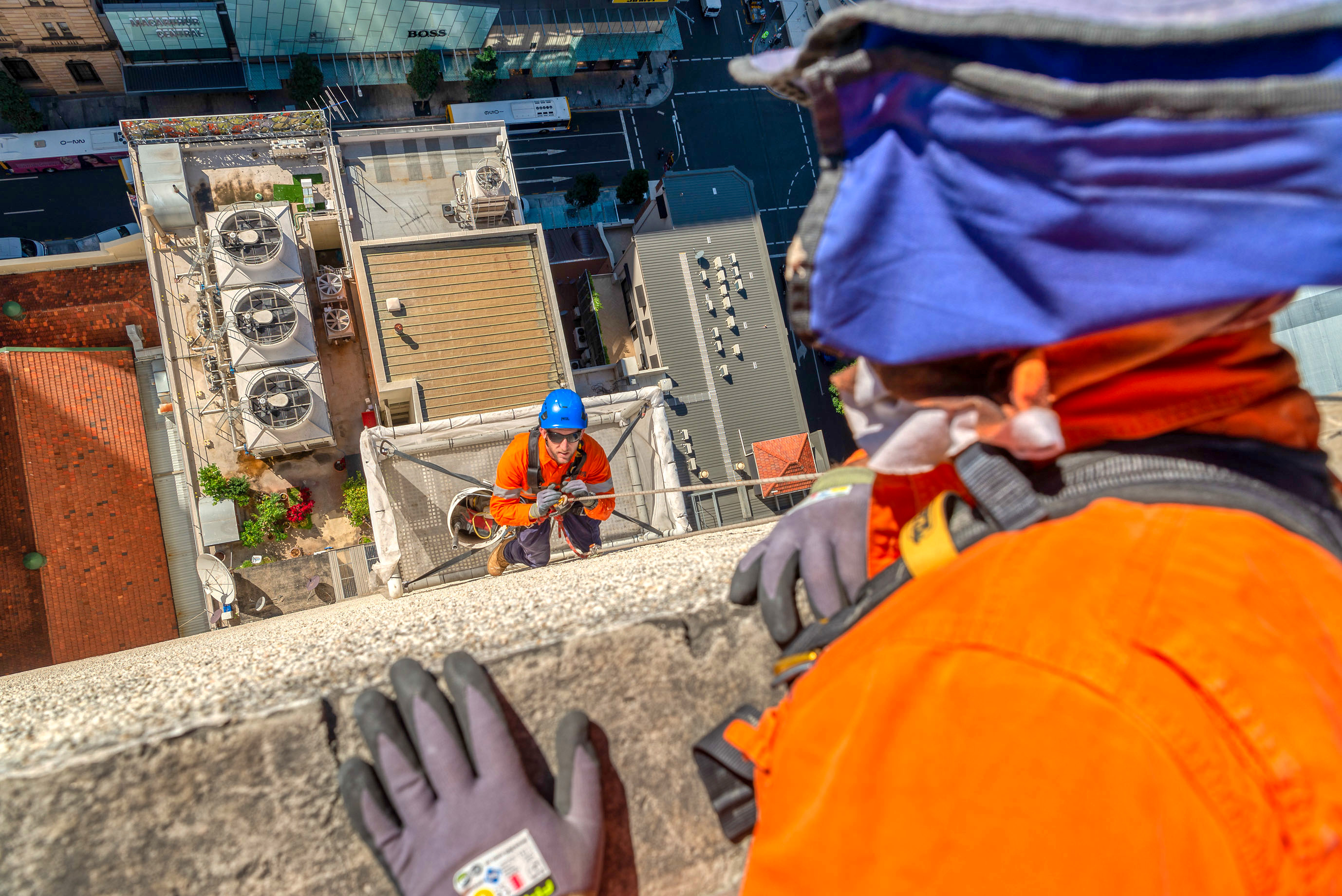 Looking over the edge of a high rise building in Brisbane captured by Rapax Construction Photography