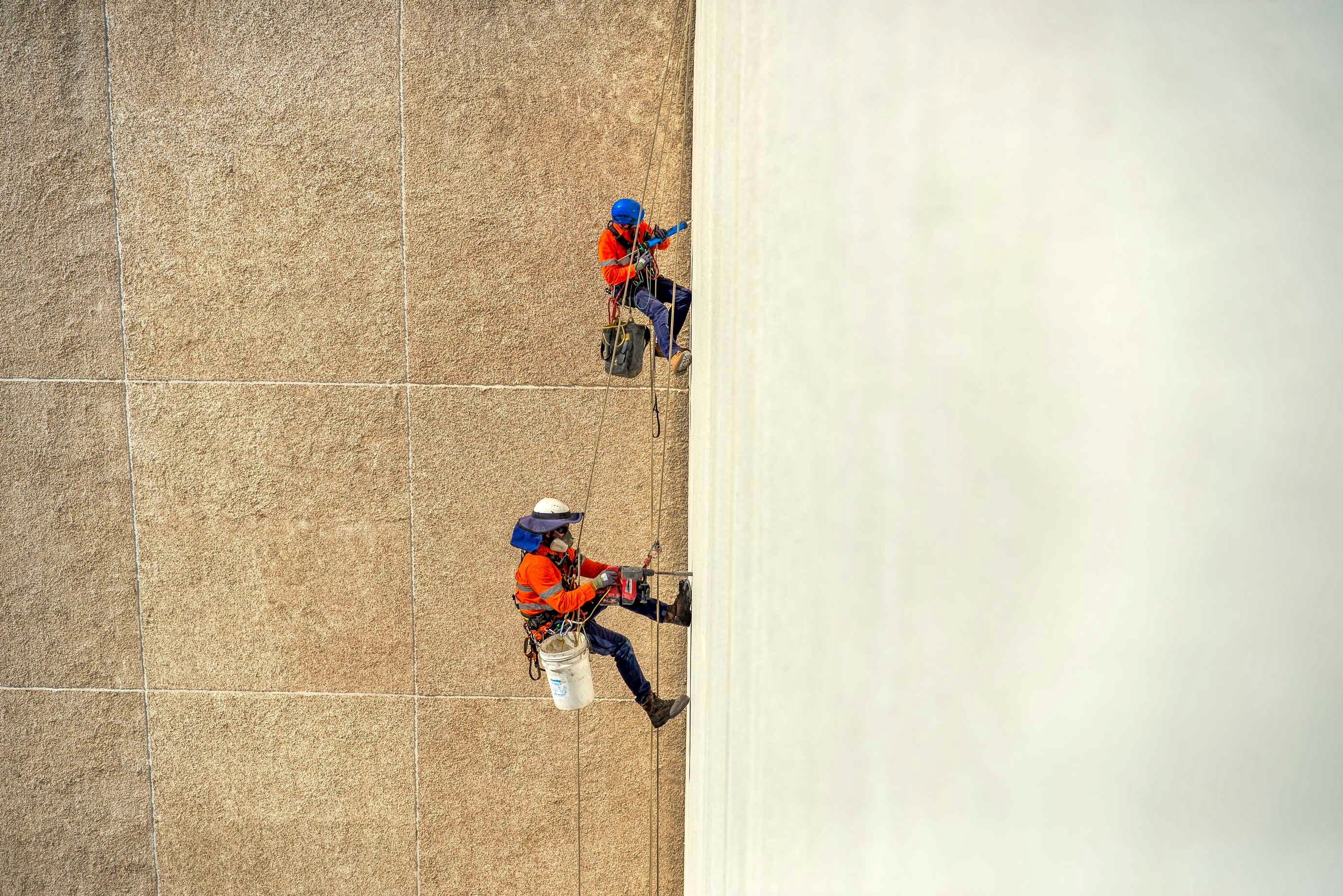 Abseiling down the side of a high rise building in Brisbane captured by Rapax Construction Photography