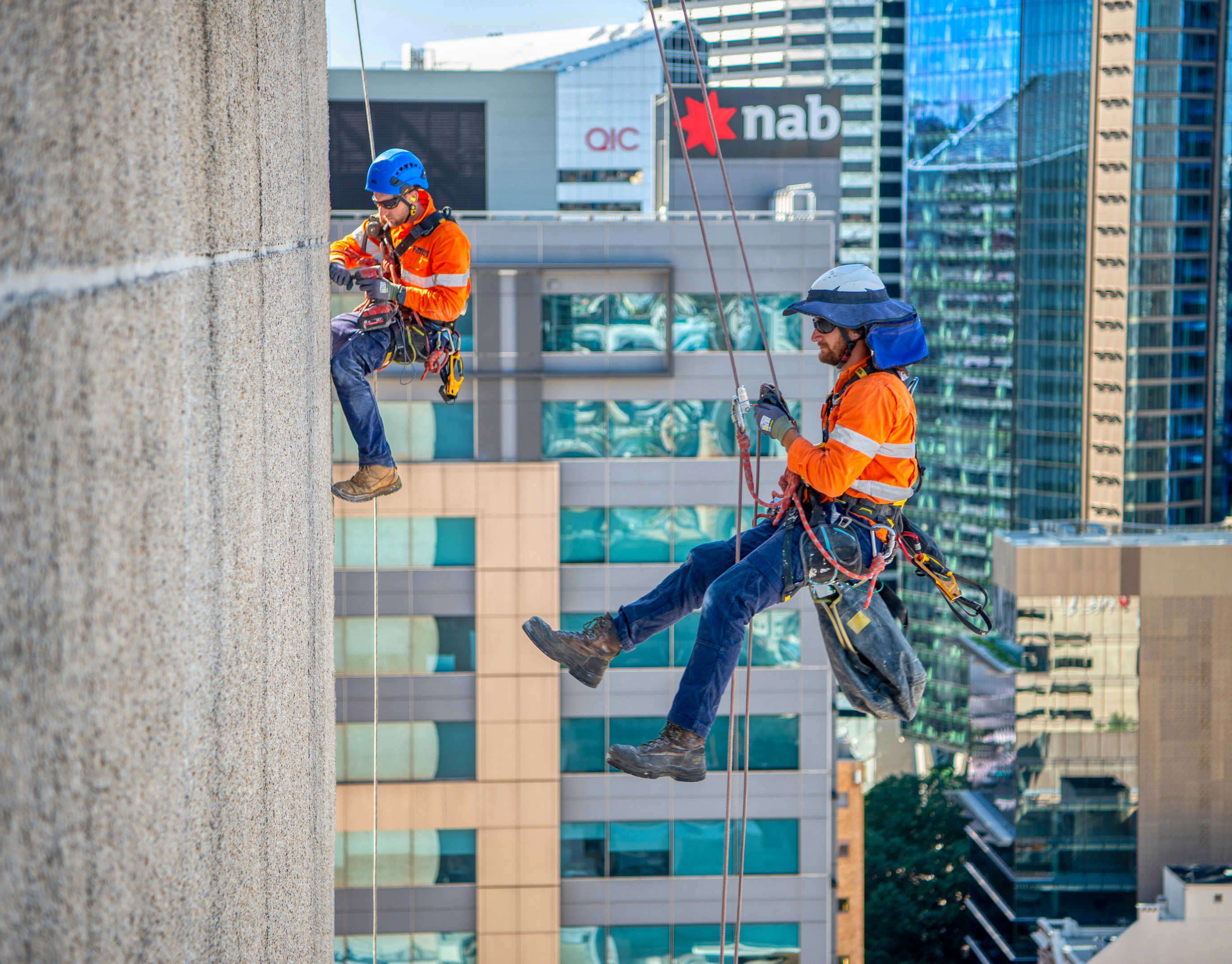 Working on the side of a high rise building in Brisbane, and captured by Rapax Construction Photography