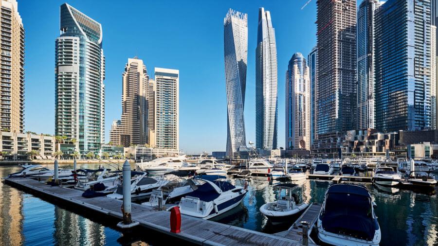 View of Dubai marina, boats and towers