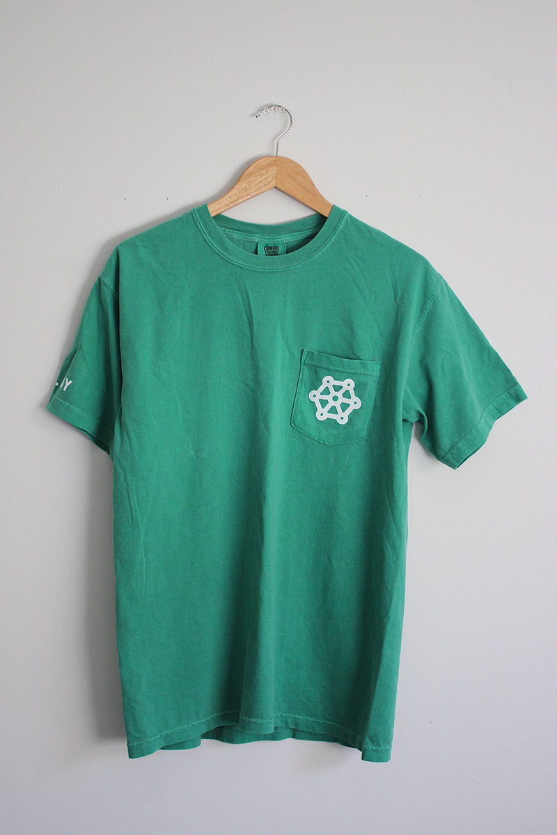 Green shirt on hanger with logo