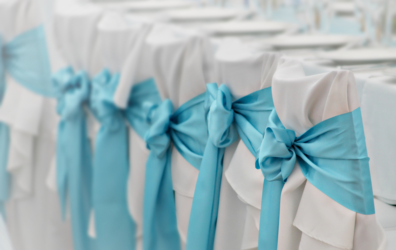 Wedding chair covering and ribbon service