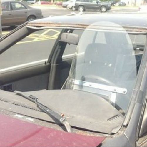 Motorbike windscreen in a car