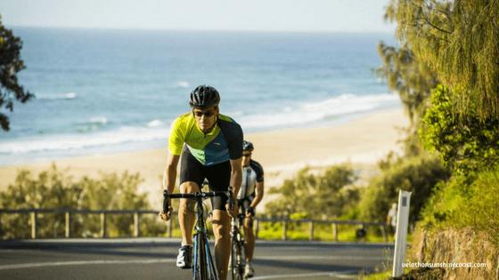 Bike riders along David Low Way