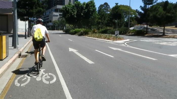 Cyclist in bike lane on Roma St in Brisbane City