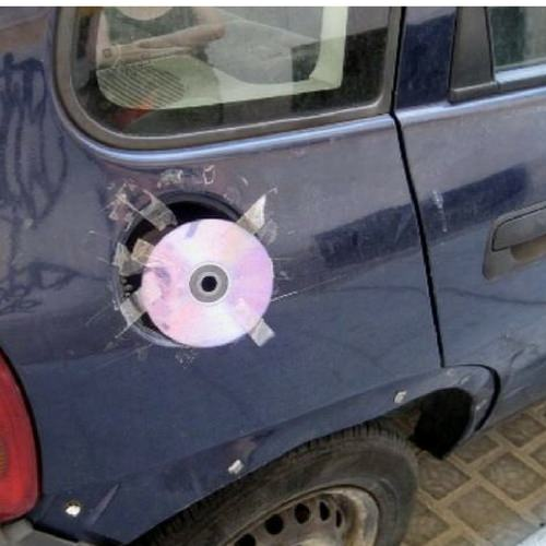 CD disc taped to car petrol refill cap