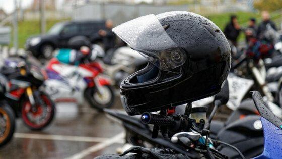 Motorcycle helmet on handlebar