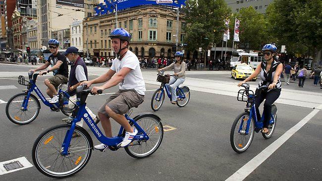636342-tourists-on-hire-bikes
