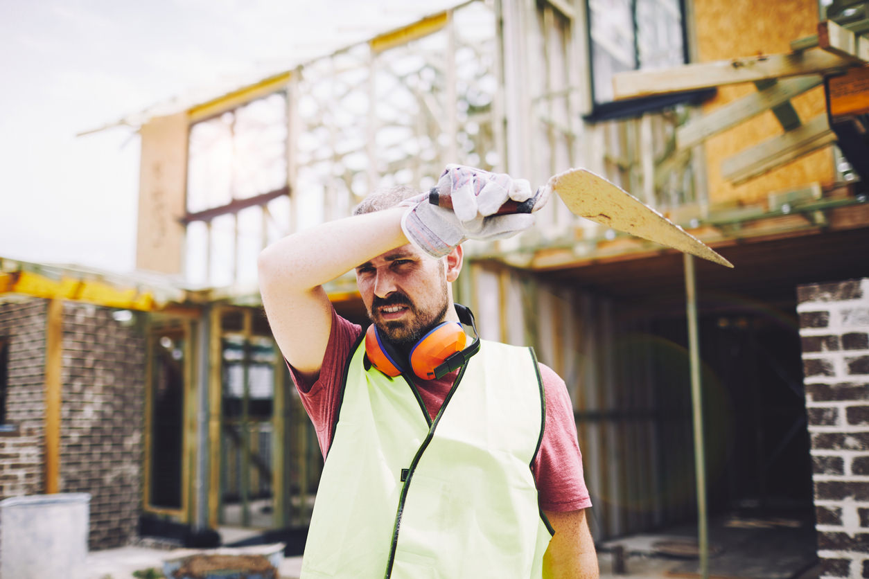 Aussie tradie on hot day wipes sweat off brow