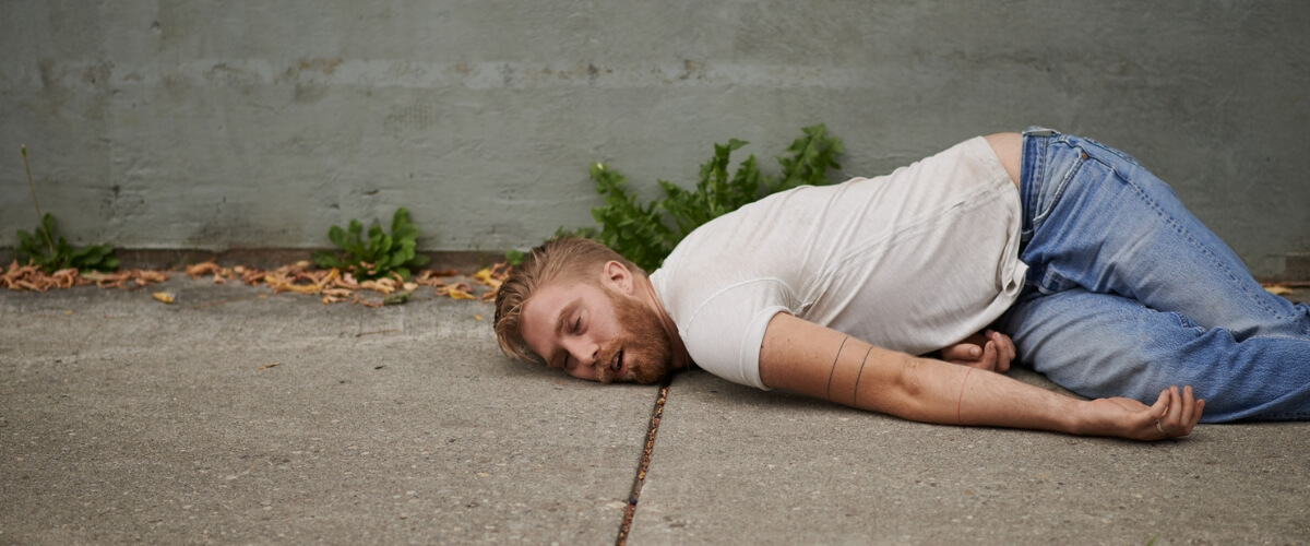 Drunk pedestrian passed out on pavement